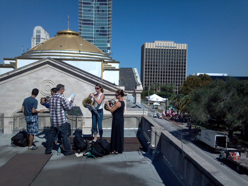Performing on a balcony, one of our locations around the city.