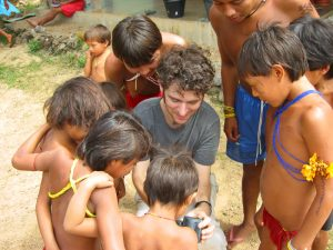 """Yanomami kids looking at my camera"""