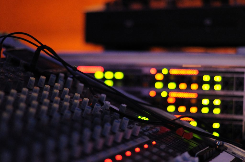 Photo: Alex Lambert. A mixing console and rack.