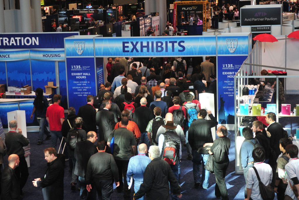 A crowd of people enter the exhibit show floor of the 135th AES Convention in New York City. Article by Adriane Kuzminski.