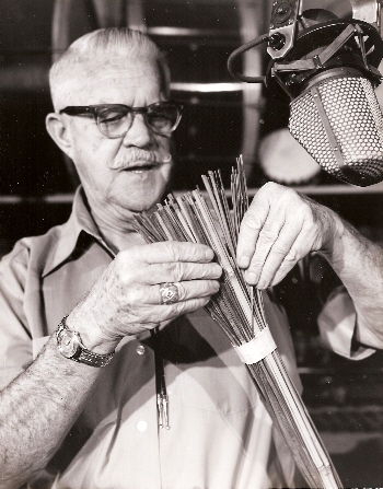 Jimmy MacDonald holding the roll of bamboo that  was used to create one of the sound layers for the devastating forest fire in Bambi.