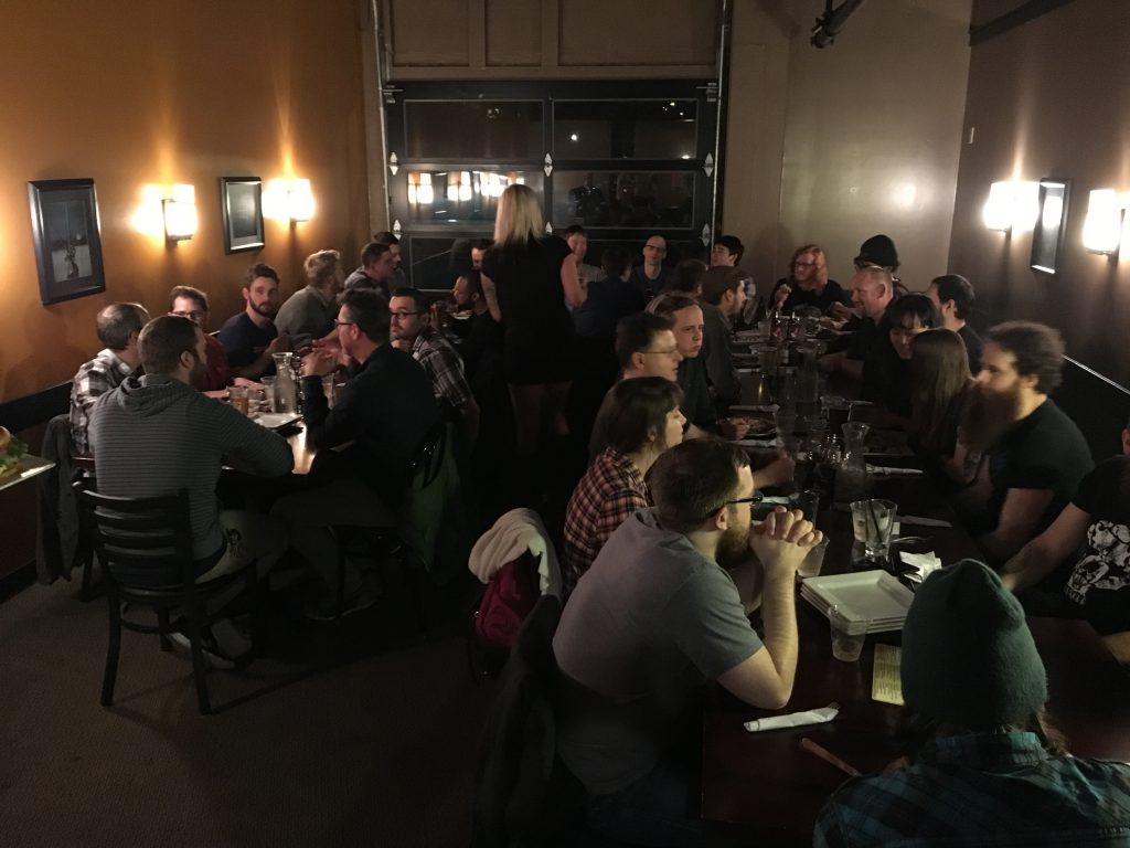 Around half the attendees keep the party going over New York Pizza Bar & Grill.