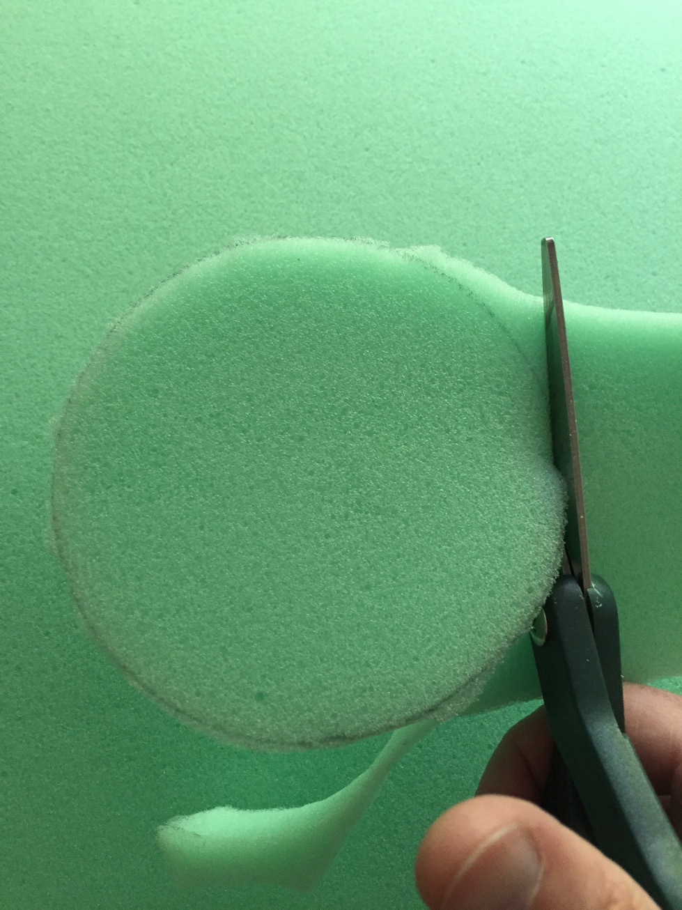 Cutting foam out with scissors