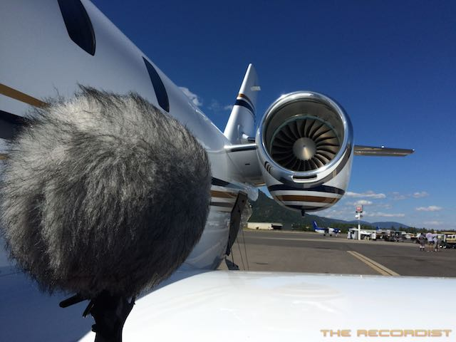 A mic with a thick wind muff faces the propeller of a private jet. Article edited by Adriane Kuzminski.