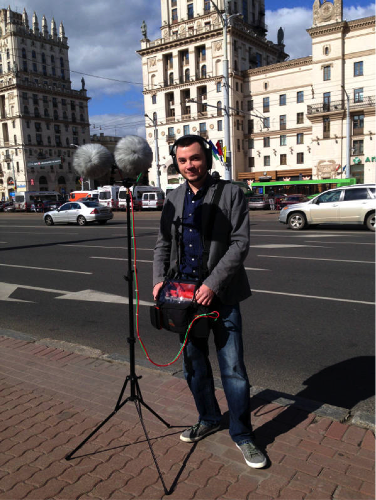 Serj stands in beautiful Minsk across the street from the Twin Gates buildings.