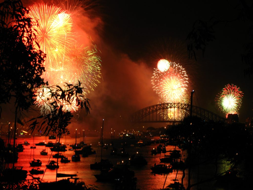 Fireworks light up the sky above a port in Sydney, Australia. Article by Adriane Kuzminski.