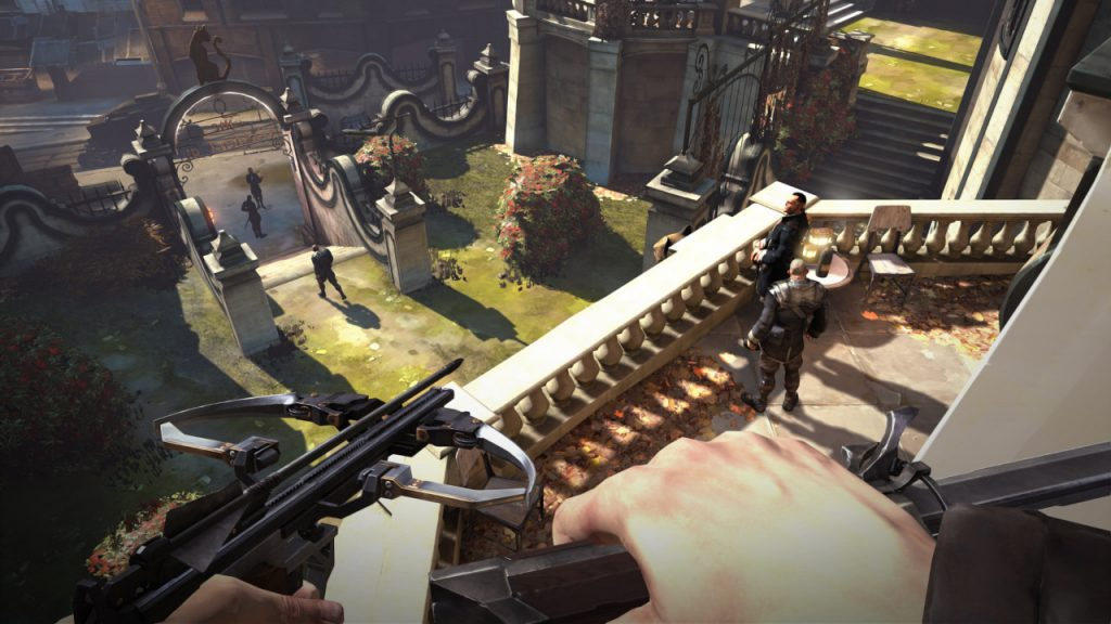 Emily crouches on a platform high above several enemies in a courtyard